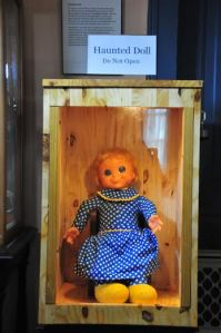 photo of haunted doll in box